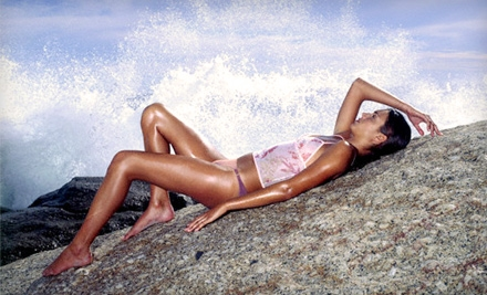One Sunless Spray-Tanning Session or a Month of Unlimited UV Tanning or at Club Sun Tanning Salon