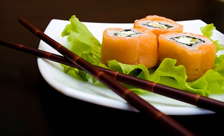 $25 for a Sushi Dinner for Two at Ku Sushi and Japanese Cuisine (Up to $52.50 Value)